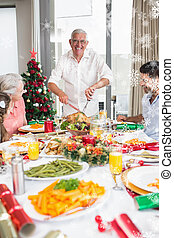 Composite image of cheerful family at dining table for christmas
