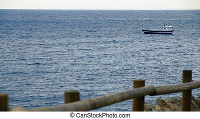 Ship Sailing - Anchored boat in the Mediterranean Sea. View...