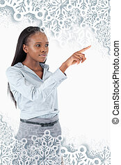 Composite image of portrait of a young businesswoman pressing an