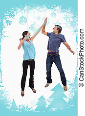 Composite image of portrait of a couple jumping together -...