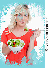 Composite image of young blonde woman eating a vegetable salad