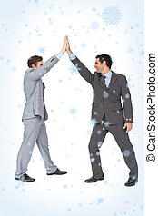 Composite image of unified business team high fiving each...