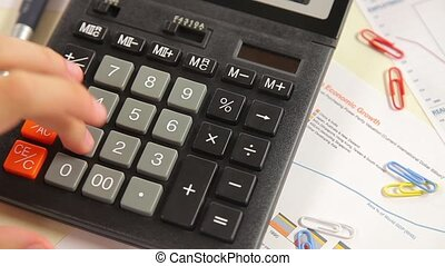 Business man working with calculator in the office Account...