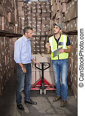 Warehouse manager talking