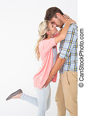 Romantic young couple about to kiss - Side view of romantic...