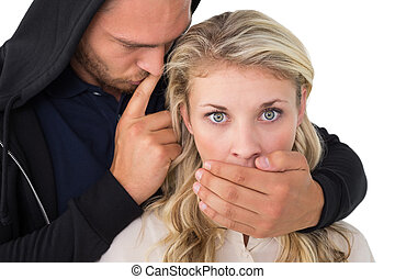 Theft covering young woman's mouth - Close up of theft...