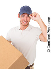 Portrait of smiling young delivery man standing over white...