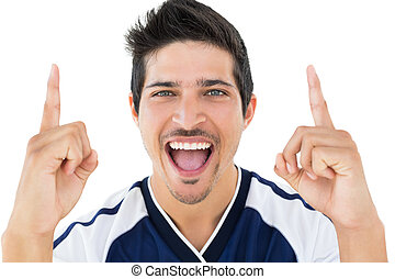 Close up portrait of football player cheering over white...
