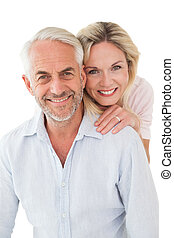 Close up portrait of happy mature couple over white...