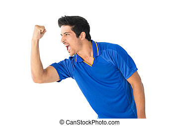 Athletic football player cheering over white background