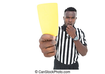 Serious referee showing yellow card over white background