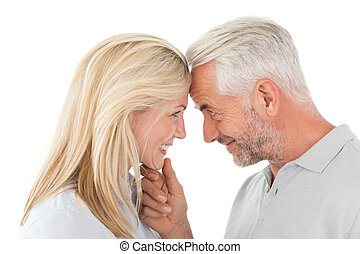 Mature couple looking at each other - Side view of mature...