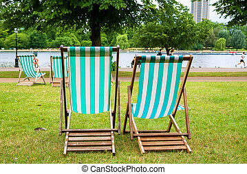 Hyde Park. London, England - Empty deckchairs in Hyde Park....