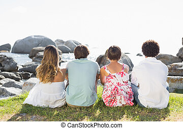 Gorgeous friends looking out to sea