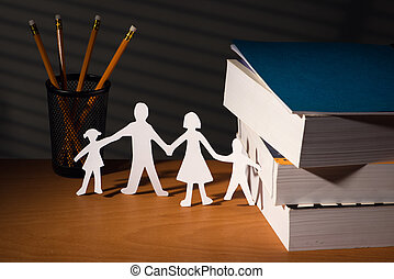 Desk with family paper in night with light of blinds