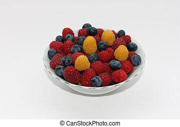 Fresh raspberries and whortleberries - red and yellow...