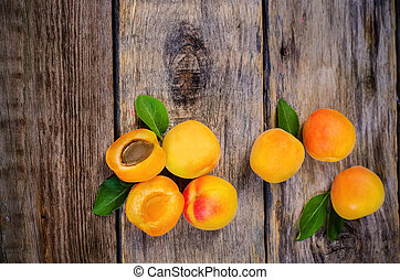apricots on a dark wood background. toning. selective focus...