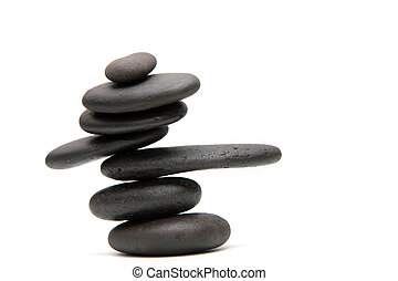 Balanced black lavas pebble isolated on white