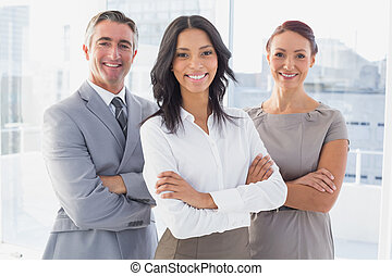 Businesswoman smiling with folded arms - Businesswoman...