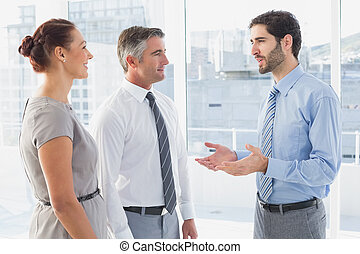 Businessman chatting with co-worker in office