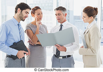 Employees having a business meeting in a conference room