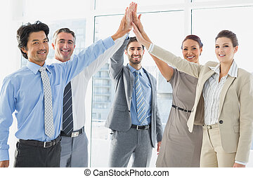 Employees celebrating a good job with a high five
