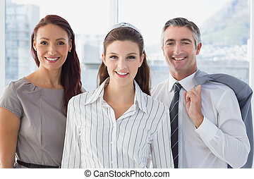 Smiling business woman with colleagues in the office