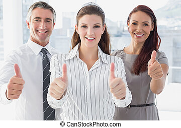 Businesswoman giving thumbs up - Smiling businesswoman...