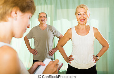 Medical staff with senior people at gym - Medical staff with...