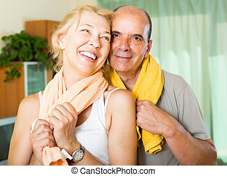 Elderly couple after training - Happy mature couple with...