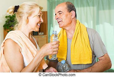 Elderly couple after training - Happy elderly couple with...