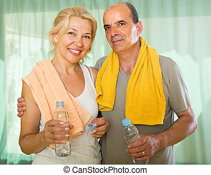 Elderly couple after training - Positive mature spouses...