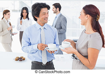 Business people enjoying their drinks while chatting