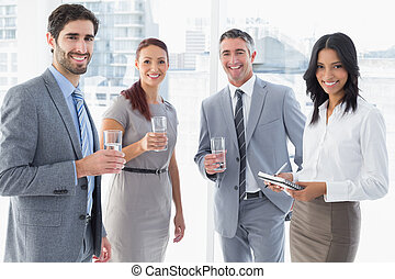 Business team having some drinks while working