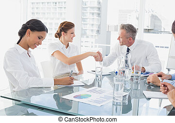 Business man introducing new employee to the company