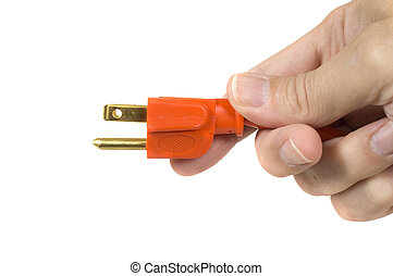Plugged In - A man\'s hand holding the end of a new orange...