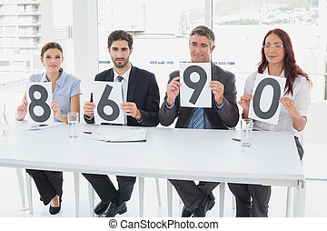 Business team giving out ratings in an office