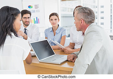Business team discussing work details in a meeting