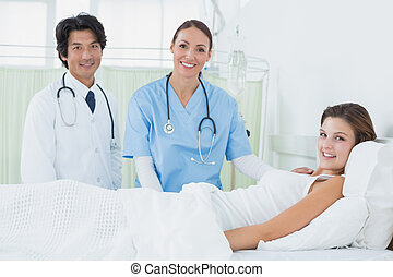Nurse and doctor checking patient