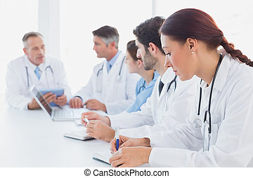 Doctors having a medical discussion in a meeting room