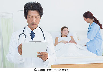 Doctor looking at a chart