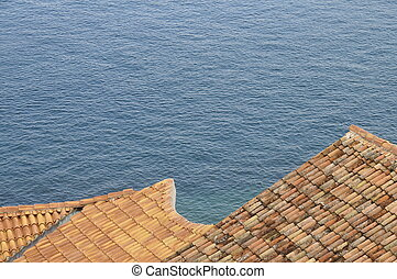 orange roofs and adriatic sea in Porec, Croatia - Details of...