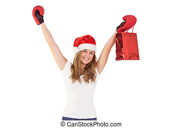 Festive blonde with boxing gloves and shopping bag on white...