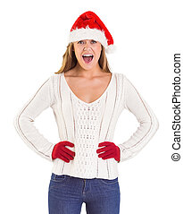 Festive blonde shouting at camera on white background