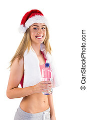 Festive fit blonde smiling at camera on white background