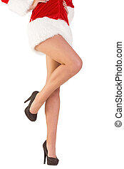 Festive womans legs in high heels on white background