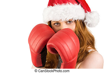 Festive redhead with boxing gloves on white background