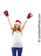 Girl cheering with boxing gloves - Festive redhead cheering...