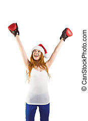 Festive redhead cheeering with boxing gloves on white...