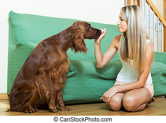 girl communicating with Irish setter - girl communicating...